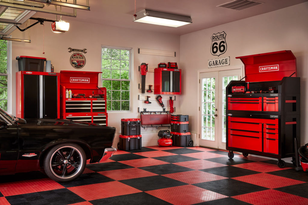 garage equiped with craftsman tools cabinets and garage door opener