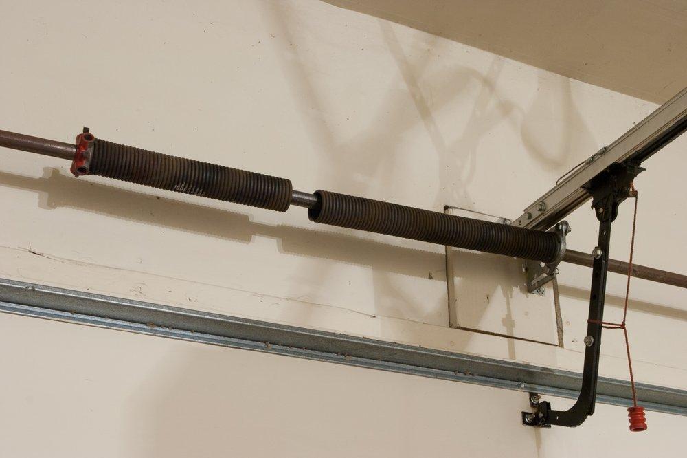 Garage Door Torsion Springs Repair and Replacement